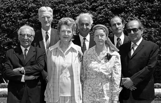 The Hands of the Cause with Counsellors of the International Teaching Centre, 1973: (front row, left to right) Mr. Ali-Akbar Furutan, Mrs. Florence Mayberry, Madame Ruhiyyih Rabbani, Mr. Abul-Qasim Faizi, (back row, left to right) Mr. Paul Haney, Mr. Aziz Yazdi, Mr. Hooper Dunbar. (Photo: Baha'i Media Bank)