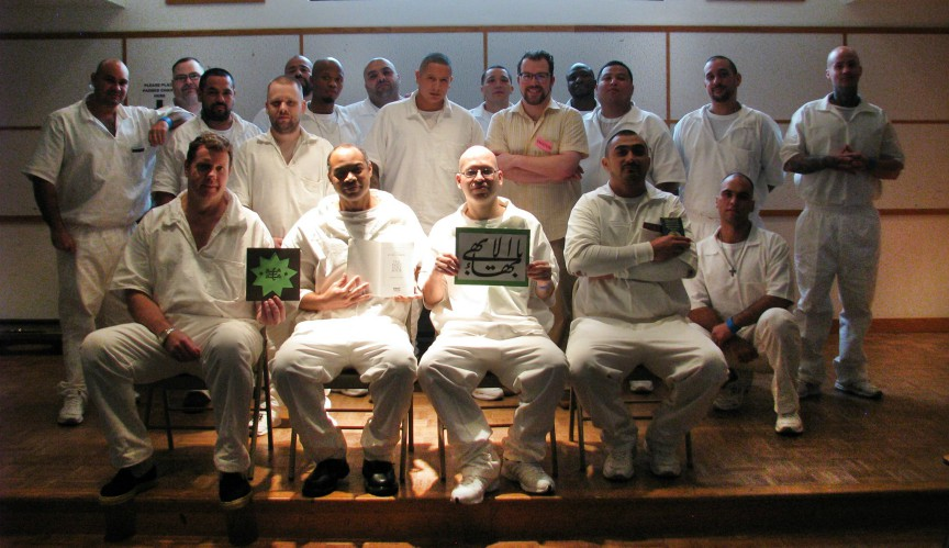 Todd Steinberg, a prison volunteer, and a group of Baha'is celebrated the Twin Holy Days at the Allred Unit prison in Texas, USA with pizza, wings, devotions and stories from the life of Baha'u'llah.