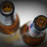Top View of Empty Beer Bottles on White Background