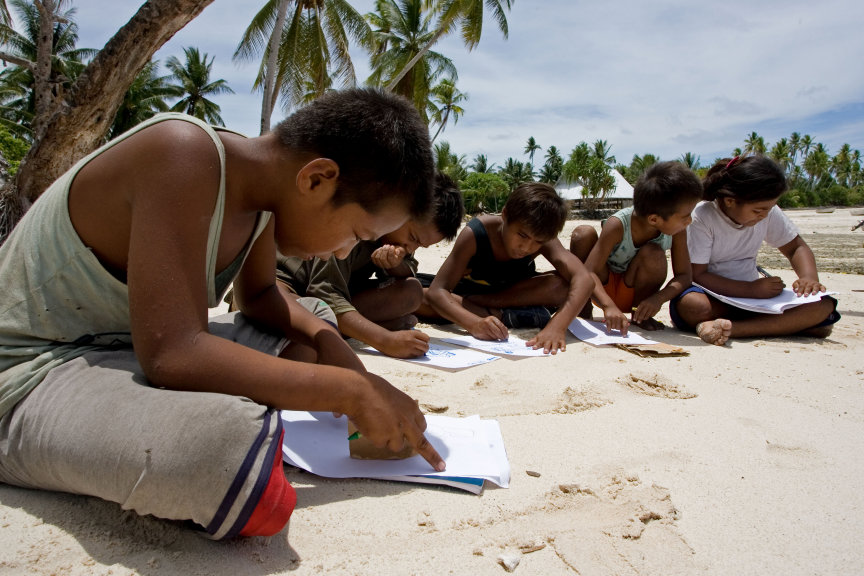 A group of junior youth in Kiribati participate in junior youth activities together.